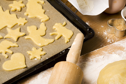 christmas cookies cut out of dough on oven rack, ingredients